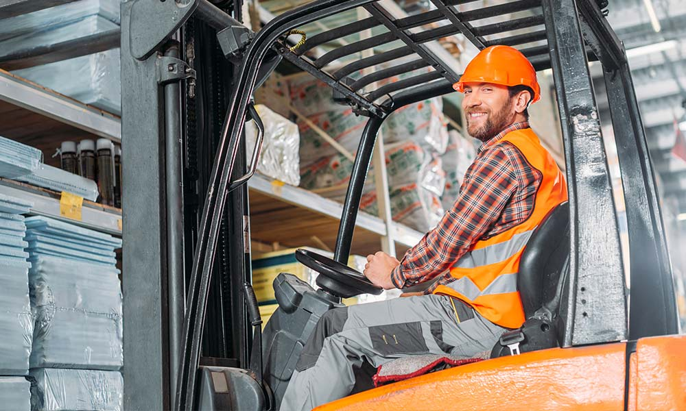 A man operating a forklift truck